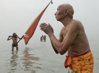 Pilgrims taking a bath in the Holy Ganges. Due to the pollution it can be an most unpleasant bath