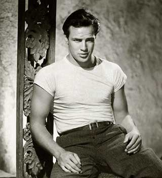 the-american-style-icon-Marlon-Brando sitting on a chair in his classic white tee